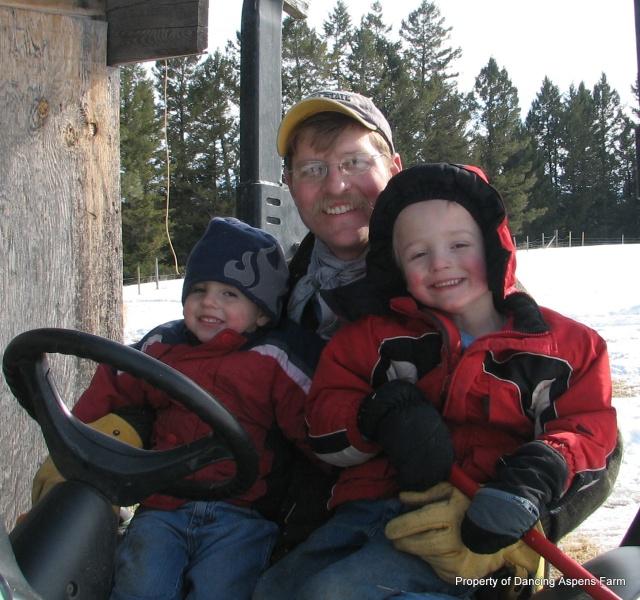 Teigen, Hayden, and their dad, working...