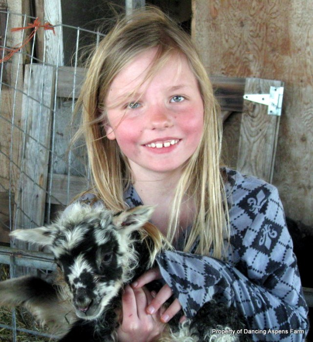 Maddie with a lamb...