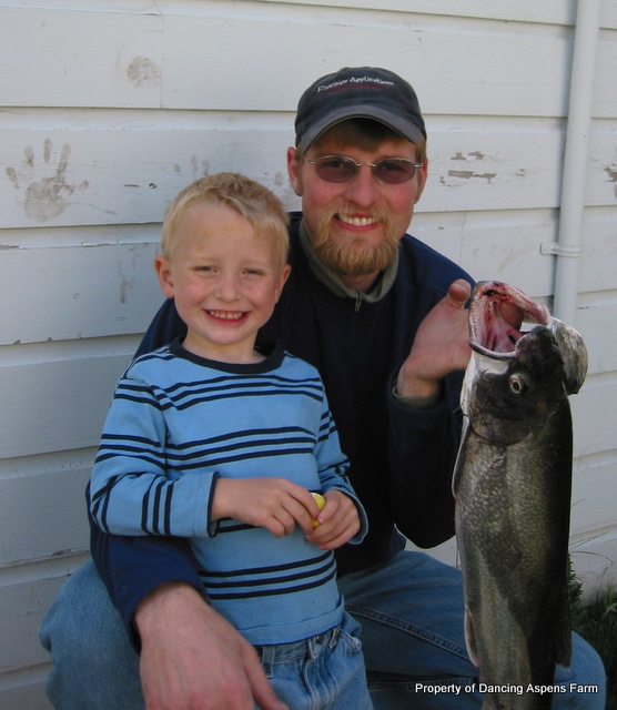 Garrett and his daddy with their catch...