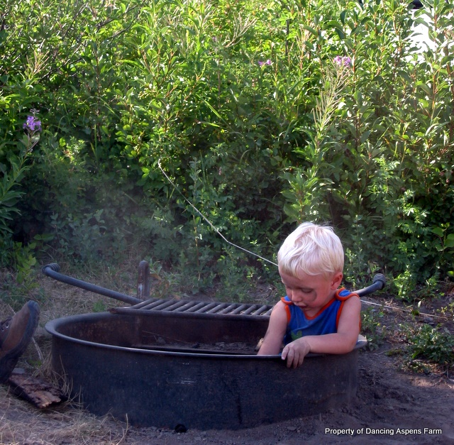 Garrett playing in a fire pit at Glacier Park...