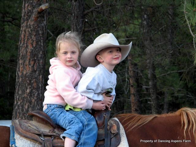 Garrett and Sage horseback riding at the ranch...