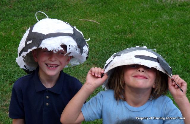 Garrett and Luke with the pinata for hats...