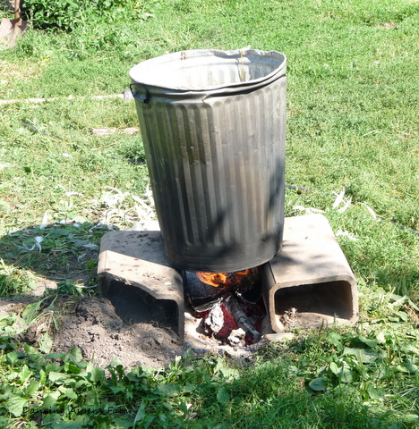 The scalder- a metal garbage can set up on two block with a fire going underneath...