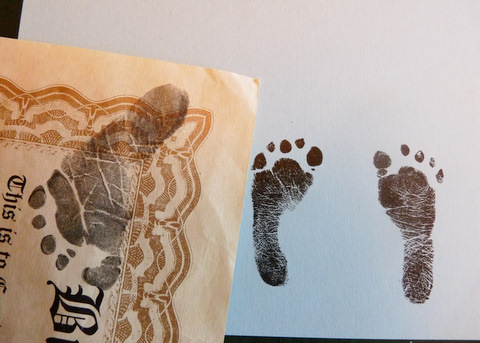 Hayden's feet (2lb 6.9oz.) next to Teigen's footprint (6lbs. 40z.)